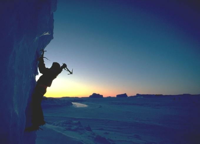 Ice climber in Antarctica with a beautiful sunrise :)