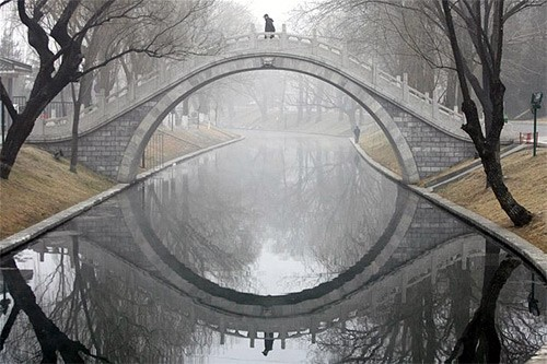 Bridge and water reflection concept