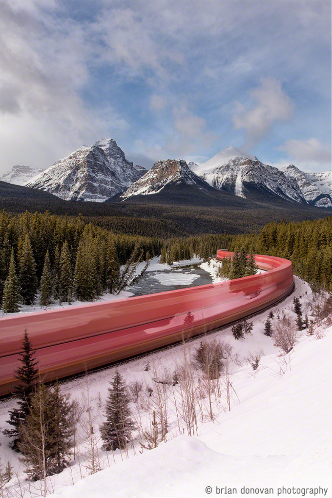 A Long Exposure Photo of a Train Roaring through the Canadian Rockies (^-^)/
