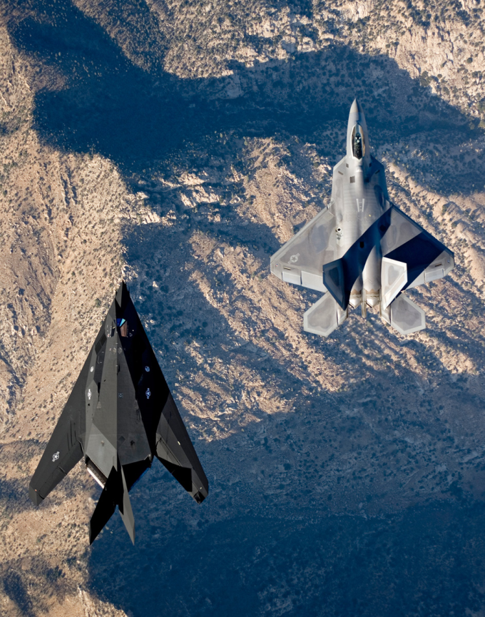 The F-22 Raptor and the F-117 Nighthawk flying side by side