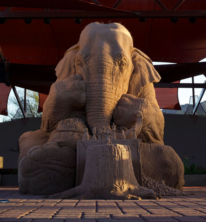 An Amazing Sand Sculpture Of An Elephant Playing Chess with a Mouse