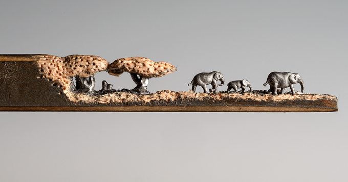 'Elephant Walk' Artist carves scene onto a Pencil