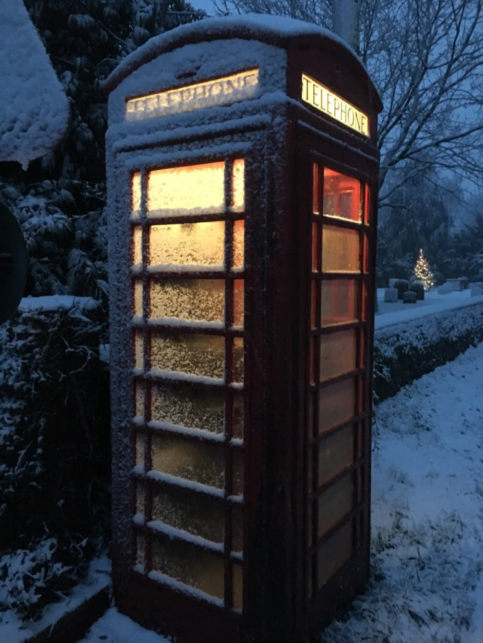 The British telephone box with a winters coating